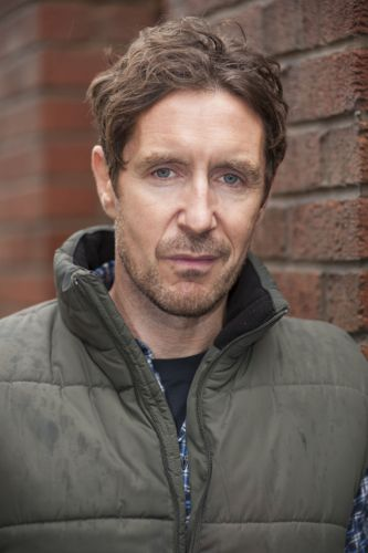 Paul McGann as Phil.