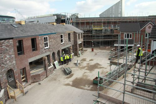 April 6 2013: Brickwork nears completion on the main terrace and the roofs are on.
