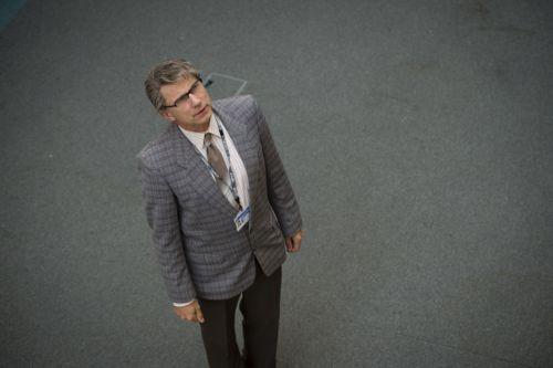 Simon McBurney as Colin Wall.