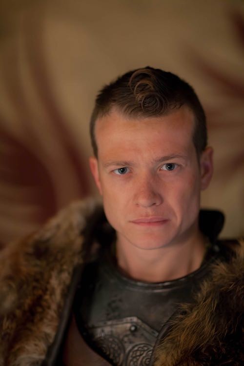 Edward Speleers as Slean.